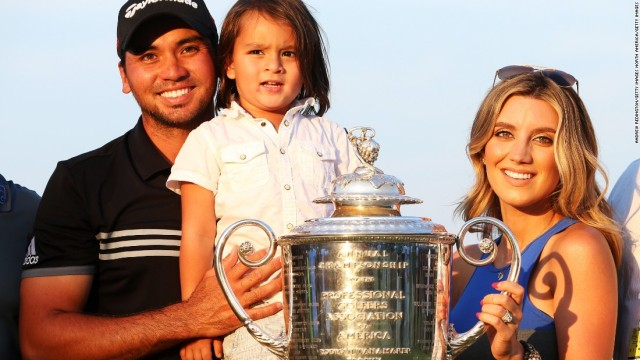 Jason Day with wife Ellie, son Dash and the Wanamaker Trophy